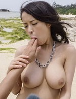 Kyouko Maki big titted sucks tools and gets doggy in threesome on sand. Japanese AV porn gallery. Hot AV model Kyouko Maki